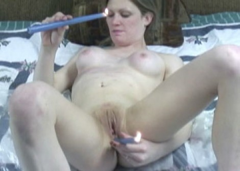 Crista fucks her ass with candles
